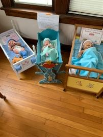 Dolls and their cribs