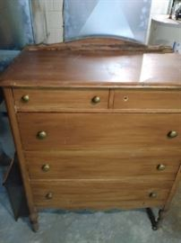 Two over three wooden dresser