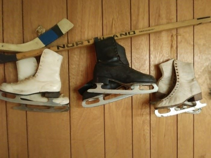 Men's and women's ice skates and hockey sticks