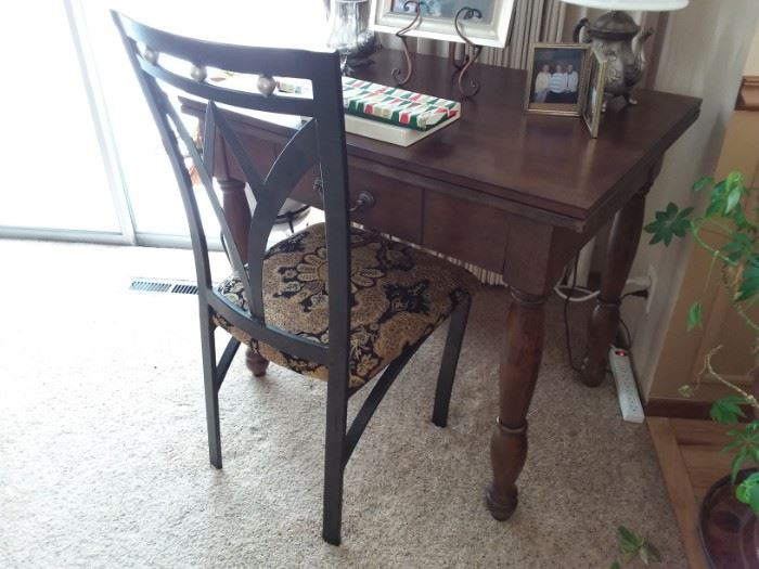 Pretty wooden conversion table. Pictured with metal art deco style chair.