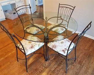 Kitchen table and four chairs. Seat covers from Calico Corners.