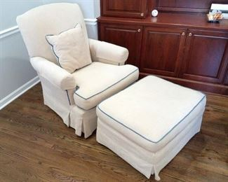 White chair and ottoman with light blue piping from Crate & Barrel