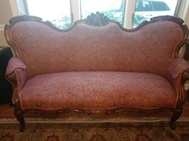 Beautiful carved sofa with very clean upholstery.