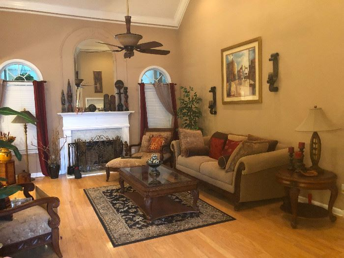 fireplace screen, lamps, area rugs, coffee table