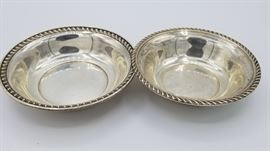 Sterling bowls, larger and smaller