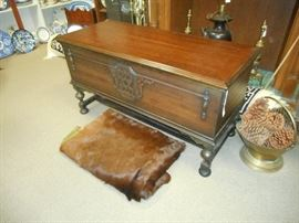 Lane Hope Chest /cedar lined in beautiful condition. and Vintage Sleight Blanket (animal hide).  Brass scuttle  with oversized pine cones
