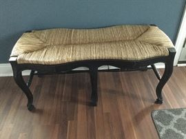 Caned bench with black legs