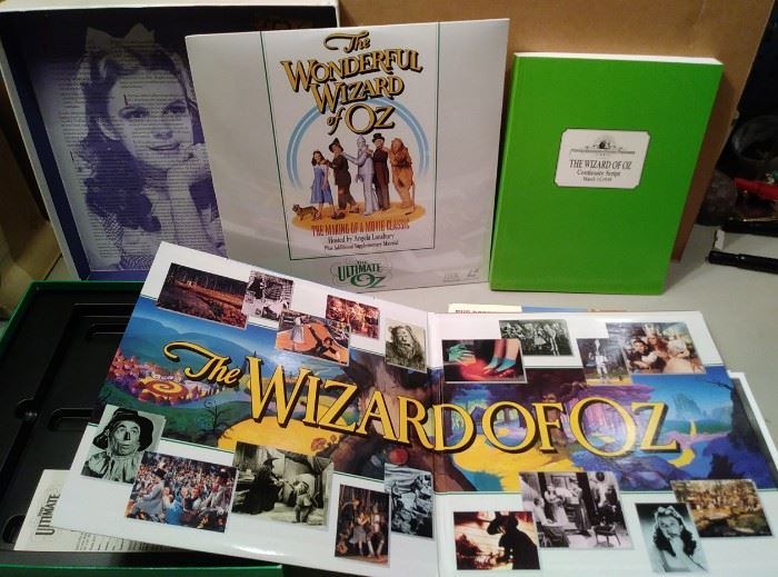 Wizard of Oz collector set full of info and the green book is a copy of the script ! also 5 B & W  movie photos...