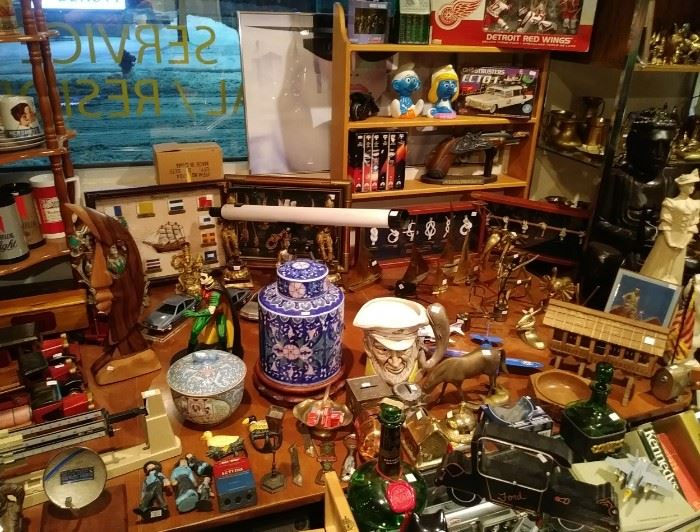 Take a close look at all the very nice items here....To name just a few....Chinese ginger pot and bowl...Nautical shadow boxes Red Wings Brass and much more....One of our unique table displays