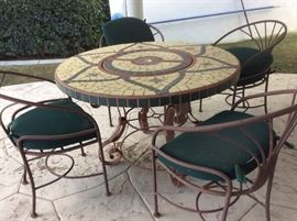 Mosaic and metal outdoor table, has 6 chairs, 4 shown.  $50