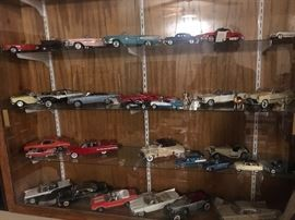 Many Franklin Mint and Danbury mint collectible cars.