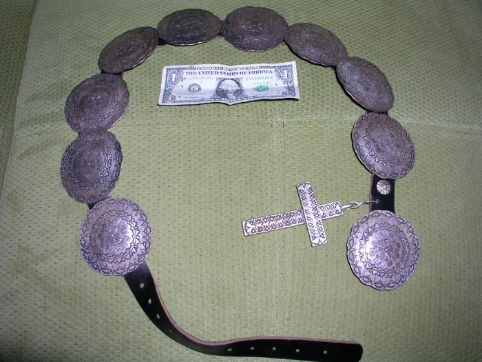Incredible sterling concho belt by W.R. Harris. Medallions are approx. 52g each, cross is 125g.