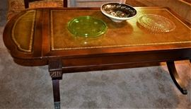 Antique Mahogany Coffee Table with Gold Leaf Trimmed Leather Inlay and Brass Claw feet