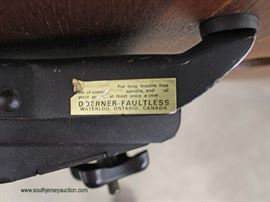 """Mid Century Modern Laminated Rosewood Eames Style Chair and Ottoman by """"Doerner Faultless"""" – auction estimate $400-$800"""