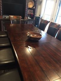 Dining room table that is extended and size is adjustable