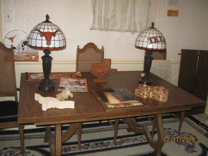 Two U. T. lamps and great dining room table with 4 chairs and leaves.