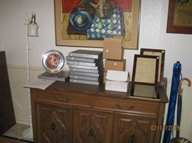 Small buffet and pewter and stained glass plate collection.Lights for mounting plates.