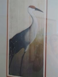 Carved woodcut of crane by Marie McDonald