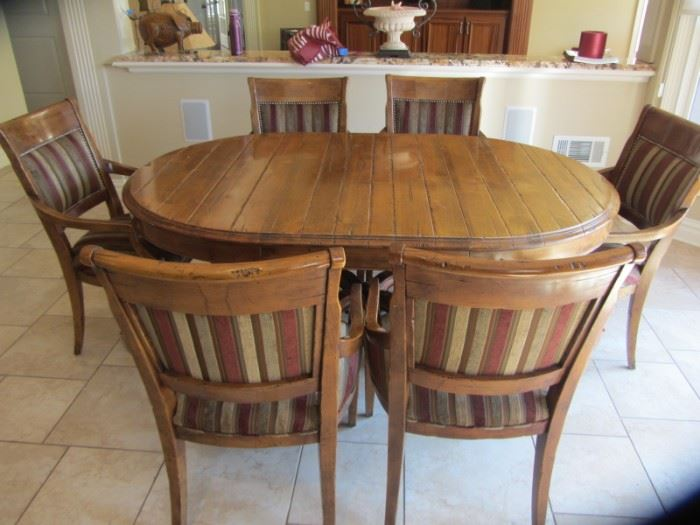 LORTS KITCHEN TABLE AND 6 ARM CHAIRS. SHOWN WITH 1 LEAF.  WITHOUT LEAF IT IS ROUND
