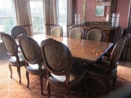 """LORTS TRESTLE DINING TABLE AND 8 CHAIRS                      84"""" X 44"""" HAS 2-12"""" LEAVES(EXTENDS TO 108"""" OR 9') AND ALL PADS"""