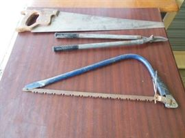 2 hand saws and loppers