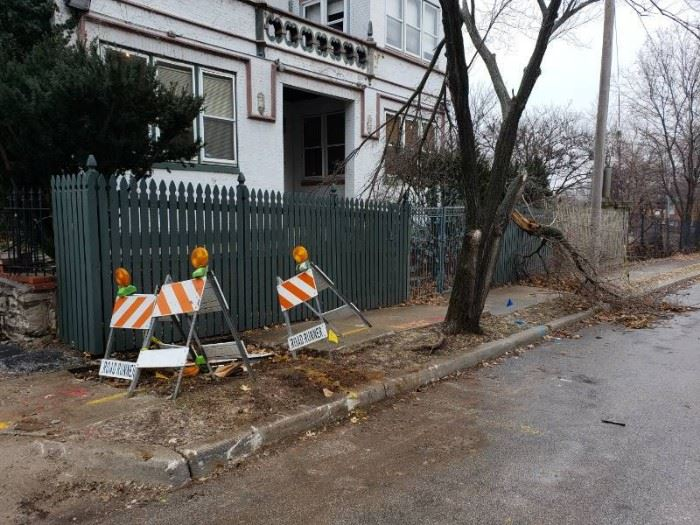 Green painted wooden fencing on front side of buil ...