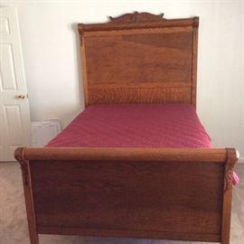High back oak antique bed.