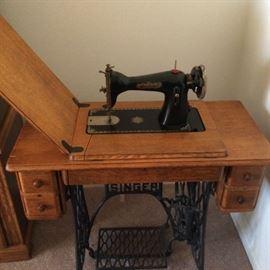 Singer machine with beautiful oak cabinet.