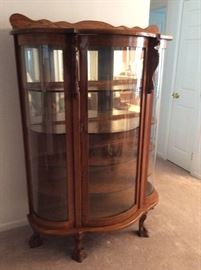 Beautiful oak bow front china cabinet with mirrored back