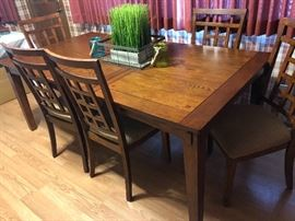 Table with one leave in center and chairs from Ashley Furniture