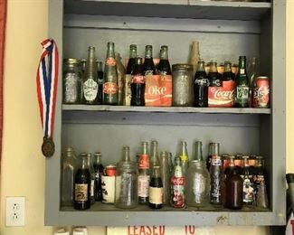 Assortment of old beverage bottles
