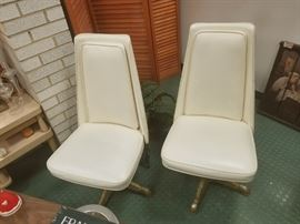(2) Mid century modern cream vinyl swivel chairs