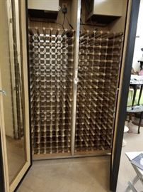 """Custom built restaurant grade Vinotemp refrigerated wine cabinet has two compressors holds over 450 bottles used only 3 years  88""""H x 50""""D x 30""""W"""