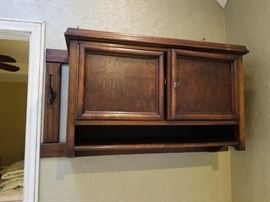 Antique hanging cabinet with hooks and shelf