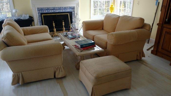 Pair of loveseats, ottoman, coffee table