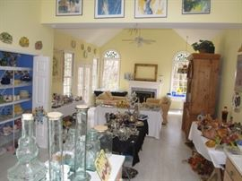 View of Great room with ceramics, glassware, silver plate, furniture.