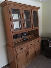 2 piece multi purpose hutch with beveled glass cupboard fronts and spacious above and below storage - is available at this sale