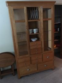 Ashley Furniture - upright Hutch - multi purpose hutch with glass cupboard door fronts and all-about drawers for dishes, flatware, linens, or kitchen wares - or use it for a display case of collectibles -  is available at this sale