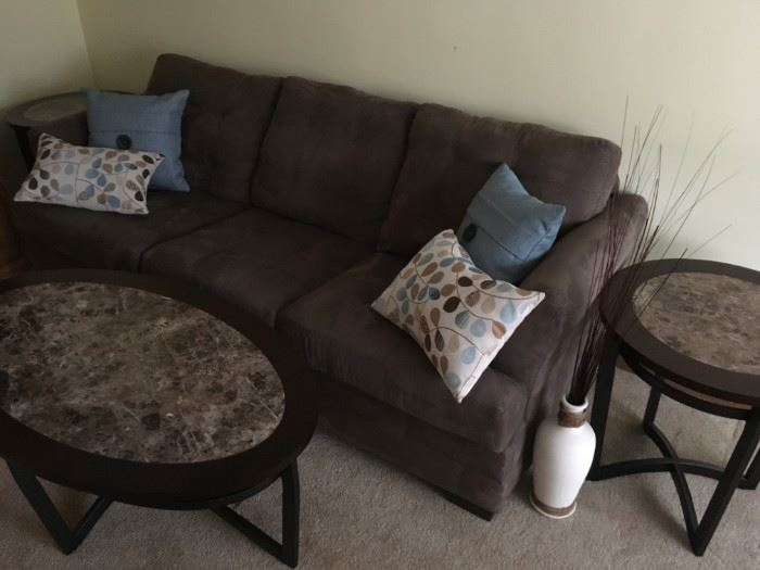 furnishings in this estate sale are updated with a fresh look - a sampling of what to expect with this microfiber upholstered piece,  wrought iron legs with marbled style table tops and accent pillows- is available at this sale