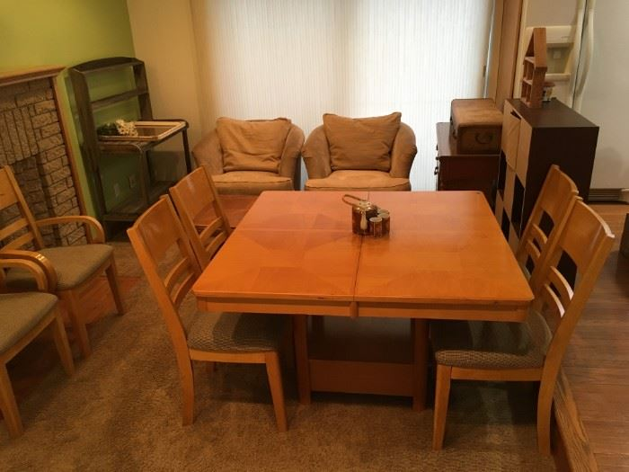 Ashley Furniture - dining set  - square table with solid wood grain patterned top - leaf Included -and- 6 cushioned chairs - 2 armed & 4 side chairs - leg area has unique lower drawer for extra storage - is available at this sale