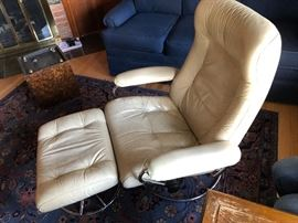Pair of Ekones Stressless Swedish mid century chairs with ottomans