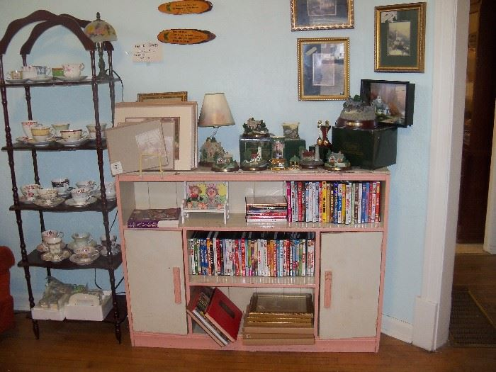 Etegere, book case, Thomas Kincade collectibles and cup and saucer collection.