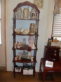 Another etagere, beer steins, phone misc smalls.
