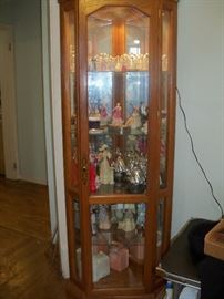 lighted curio with Mrs. Albee (Avon) figurines.