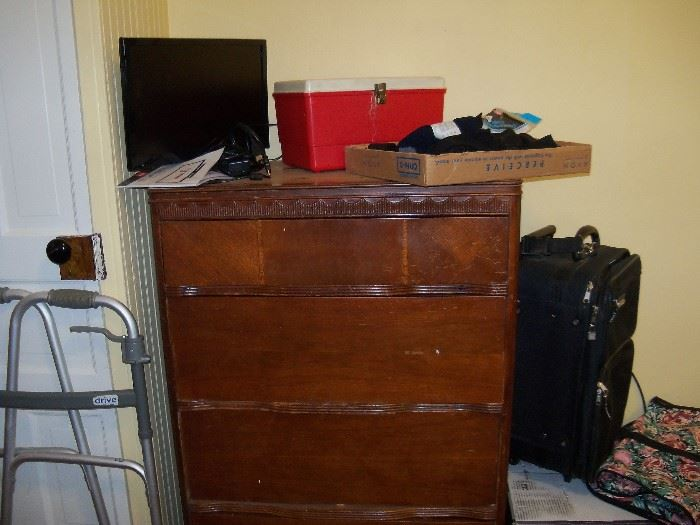 """Another chest of drawers.  19"""" TV.  Suitcase and misc."""