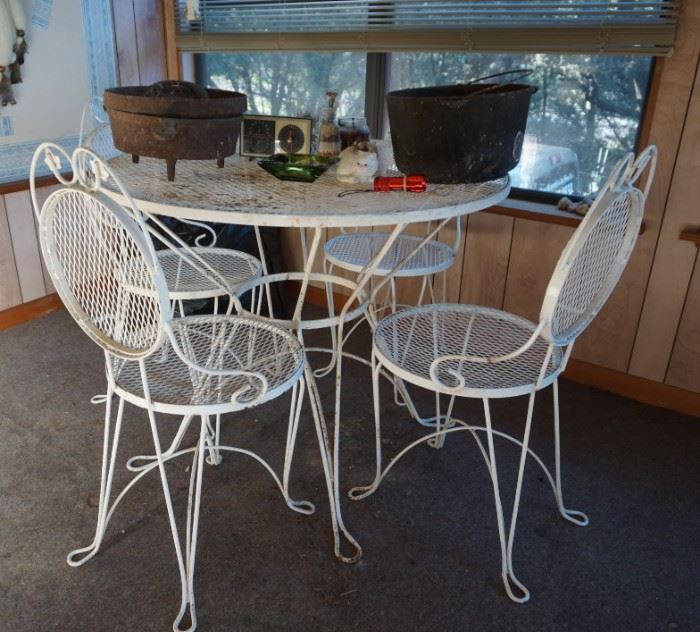 Metal patio set and cast iron pots