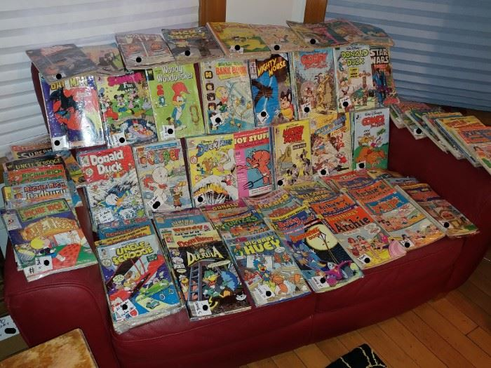 OVER 5OO COMICS BOOKS ALSO RED LEATHER SOFA FROM ITALY
