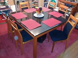SQUARE THICK BLACK GRANITE DINNER TABLE WITH SOLID CHERRY WOOD (WEIGHT ABOUT 300 LBS) AND 6 SOLID CHERRY WOOD CHAIRS WITH BLACK SUEDE LEATHER.. MADE IN DERMARK.. MATCH WITH CABINETS AND HUNT BOARD
