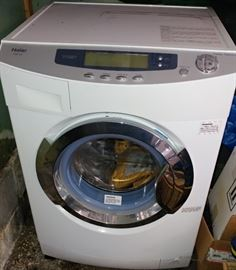 HAIER MODEL # HWD1 500.. PORTABLE FRONT LOAD CLOTHES WASHER & DRYER COMBO..  LIKE NEWS.. ONLY USE VERY LITTLE.. COME WITH MANUAL BOOK..  HAS KIT FOR WATER HOOK UP WITH KITCHEN SINK...
