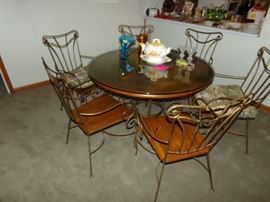 Wood and Metal Dining Room Set. Wood Top Metal Framed Table with a Glass protector. Six Chairs, very nice.